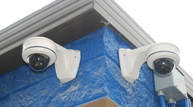 Secure digital cameras monitor property
