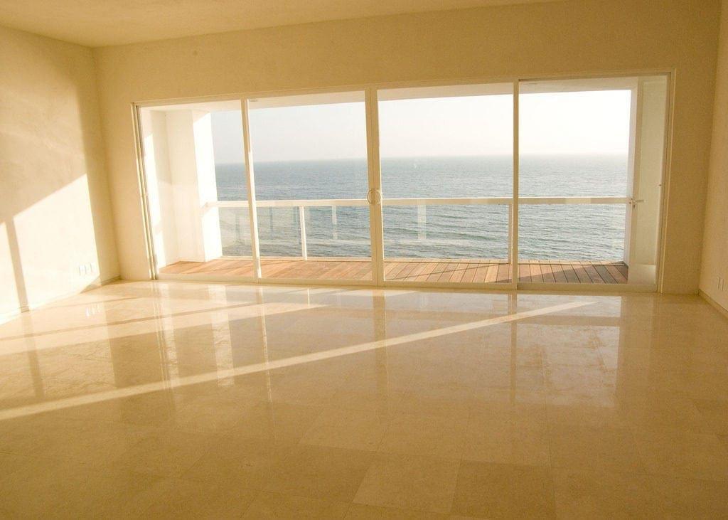 empty room with balcony overlooking ocean