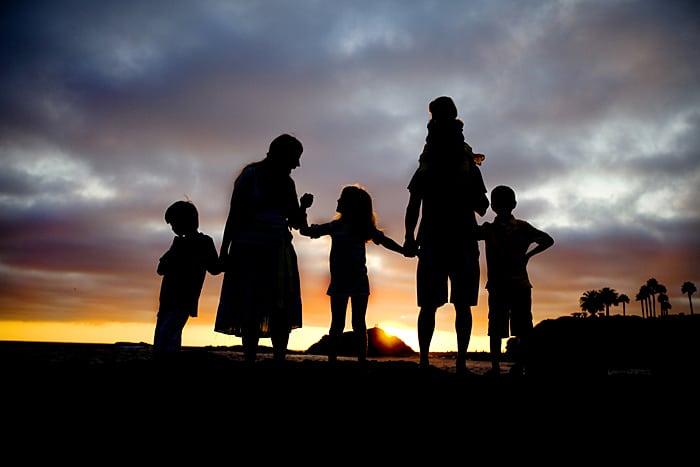 silhouette of family on horizon