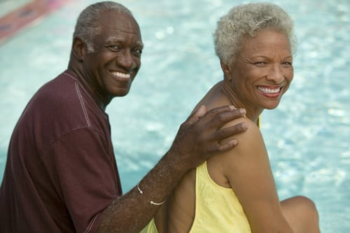 elderly couple at the pool