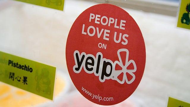 yelp sticker on window