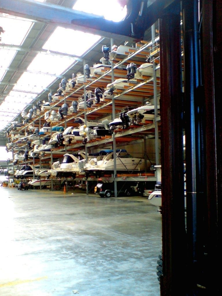 boats stacked up in a dry dock warehouse