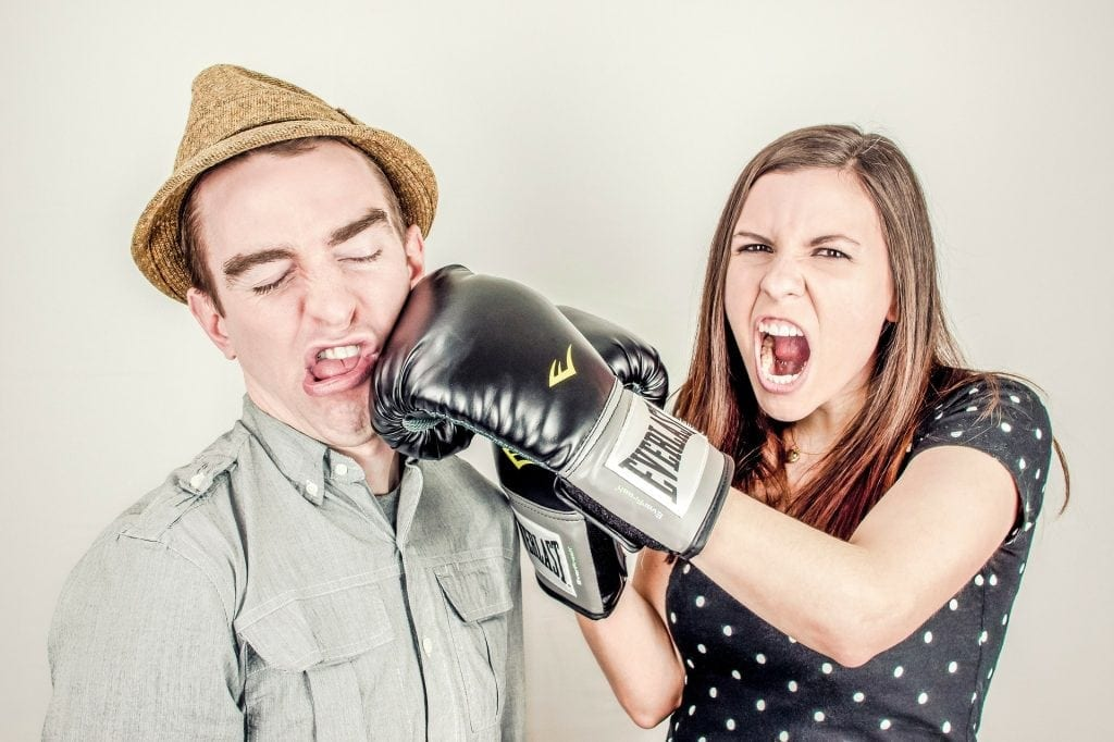 women punching man