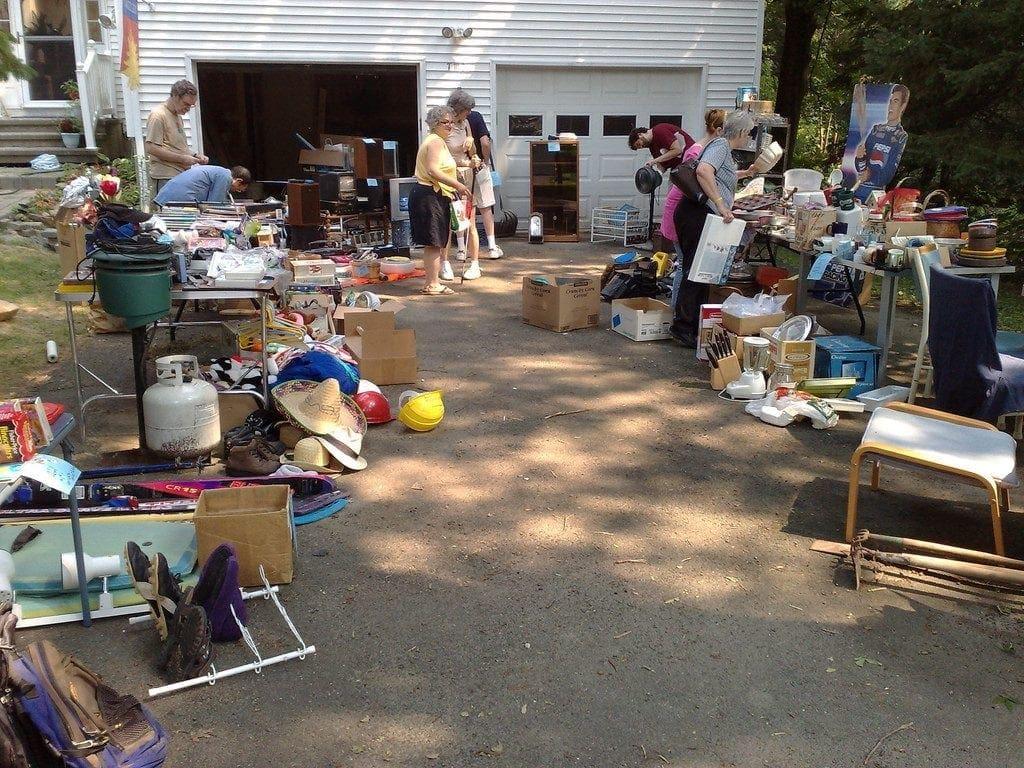driveway full of garage sale items