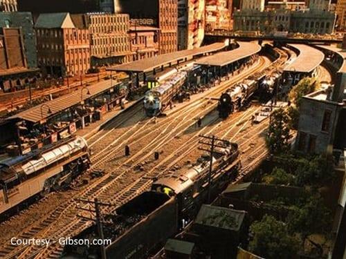Model Train display - multiple tracks in front of model buildings