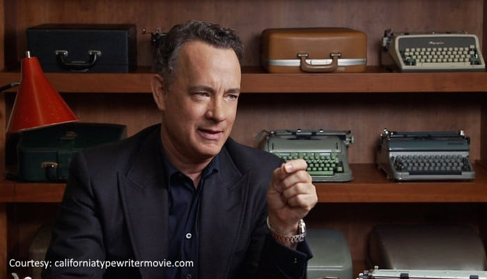 Tom Hanks in front of typewriters