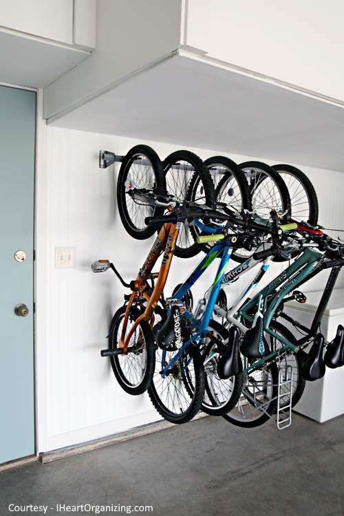 bikes hanging from a wall in a garage