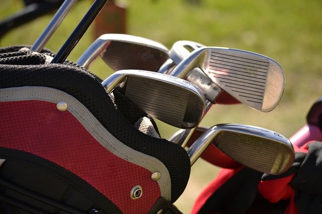 close up picture of golf clubs in a golf bag