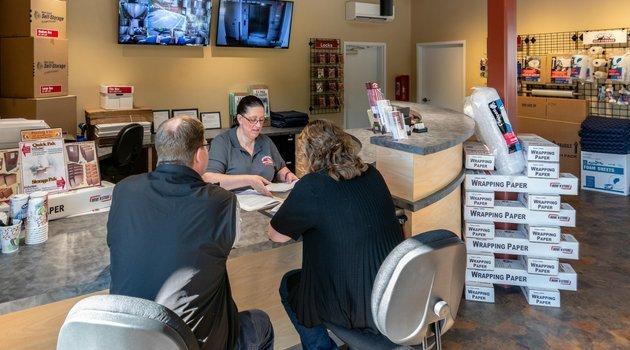 Helping customers at storage rental counter in Arlington, Washington