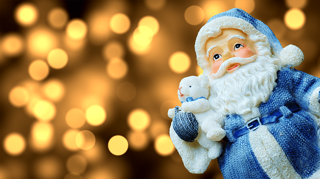 picture of santa claus figurine in front of lights