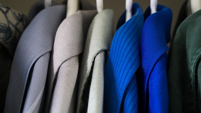 closeup of clothes on hangers