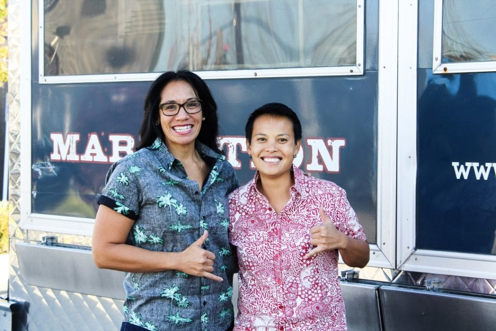 Roz Edison and Kamala Saxton standing in front of their Marination Food truck
