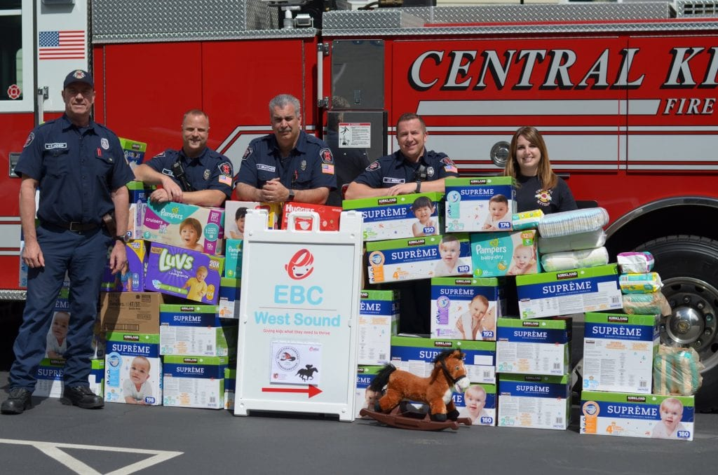 Firemen with diapers collected