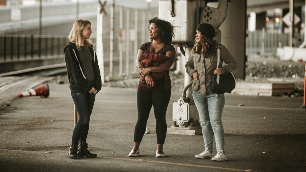 young women on the street talking