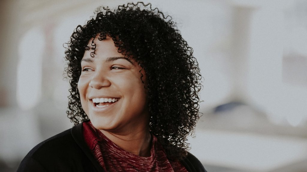 Smiling woman looking left